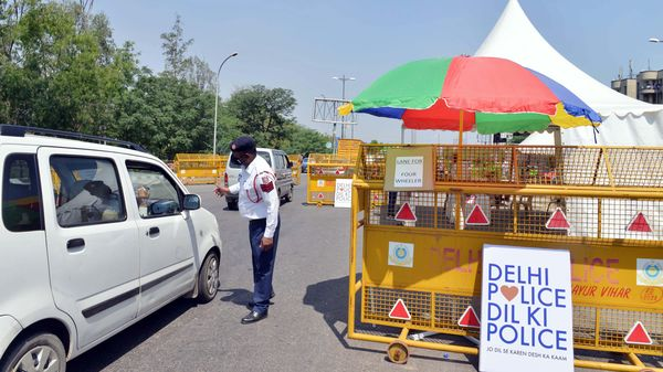 Police check vehicle at a checkpoint set up on road in Noida-Delhi Border during the nationwide lockdown, imposed in the wake of Coronavirus pandemic, in New Delhi. (ANI Photo)