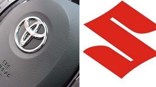 Logos of Toyota (L) and Suzuki (R)