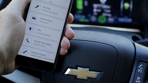A mobile phone displays the OnStar app inside a Chevrolet Volt. (File Photo) (Reuters)