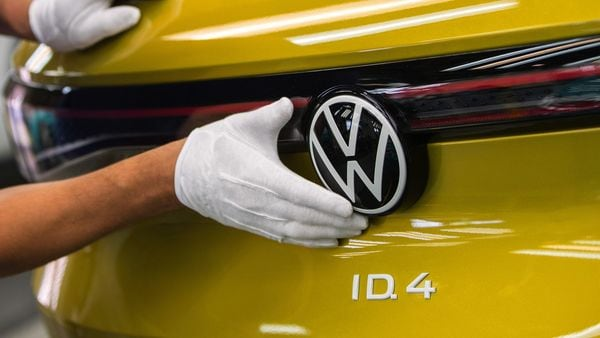 An employee carries out final quality checks on a Volkswagen ID.4 sports utility vehicle (SUV) at the Volkswagen AG electric automobile factory in Zwickau, Germany. (Bloomberg)