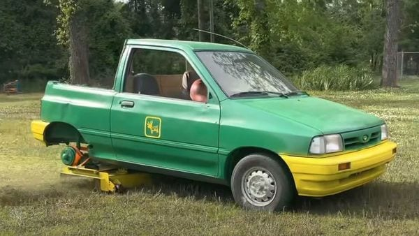 The Ford Festiva has been modified into a lawnmower by cutting the rear profile. (Image: YouTube)