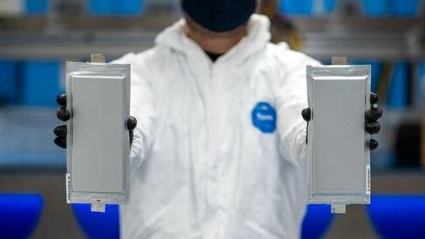 A Solid Power manufacturing engineer holds two 20 ampere hour (Ah) all solid-state battery cells for the BMW Group and Ford Motor Company. (via REUTERS)
