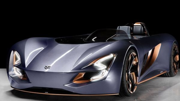 The two-seater car, inspired by motorcycles, shows how car designs have evolved over the years. The all-electric roadster concept gets a suave appearance that certainly comes with aerodynamic efficiency.