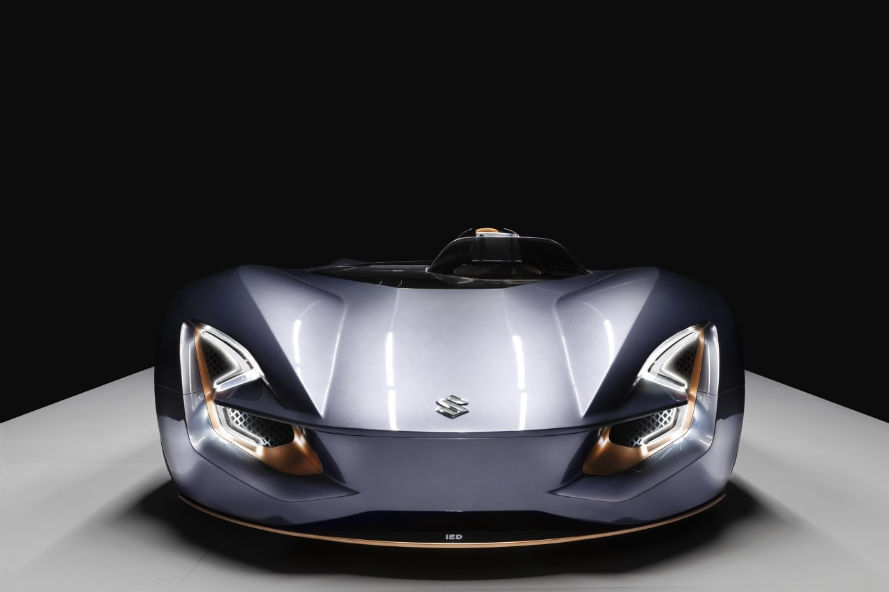 The vehicle is compact in size, measuring just 4 meters in length. Just like in a motorcycle, the passenger seat is located behind the driver's seat. It gets S-shaped LED headlamps with a horizontal split at the centre.
