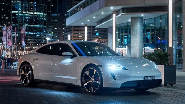 Porsche has taken its all-electric Taycan to Australia and at the debut, the car was greeted with a dramatic display in Sydney, connecting the brand's history with an electric future.