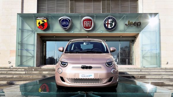 The logo of Stellantis, the world's fourth largest automaker after Fiat Chrysler and PSA finalised their merger, is seen next to a car displayed. (File Photo) (REUTERS)