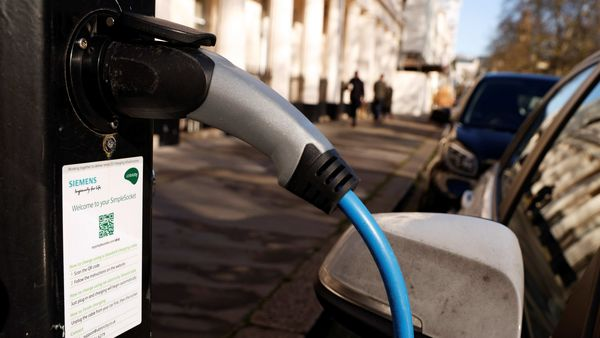 A vehicle is seen charging at an electric vehicle charging point. (REUTERS)