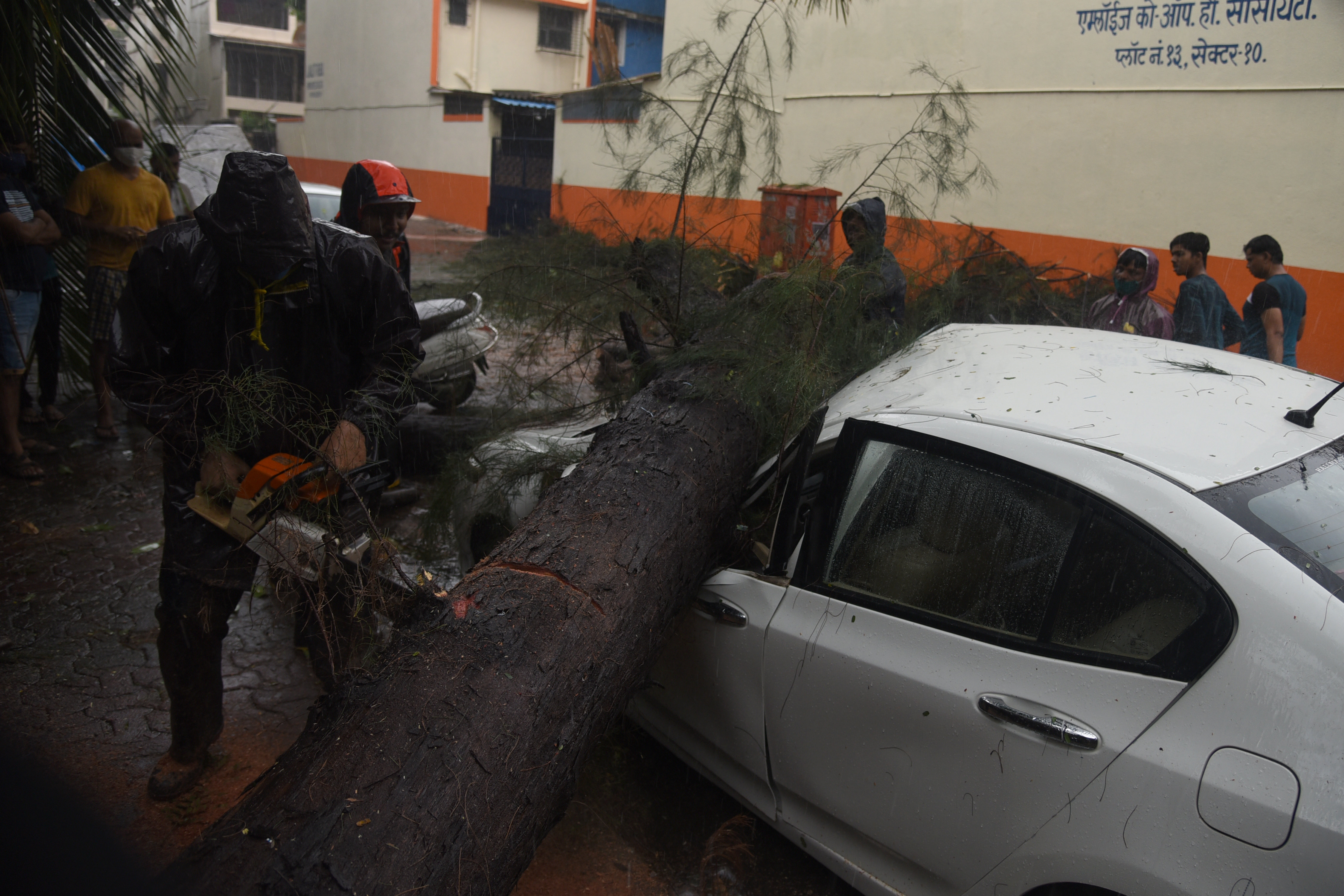 As the speed of the gales went up to 85 kmph many trees were uprooted in the city. Here, a tree fall on a parked Honda Car in Navi Mumbai on Monday.