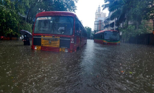 Stranded buses can be seen in a heavily water-logged area in Mumbai on Monday. The city received heavy to very heavy rainfall due to cyclone Tauktae.