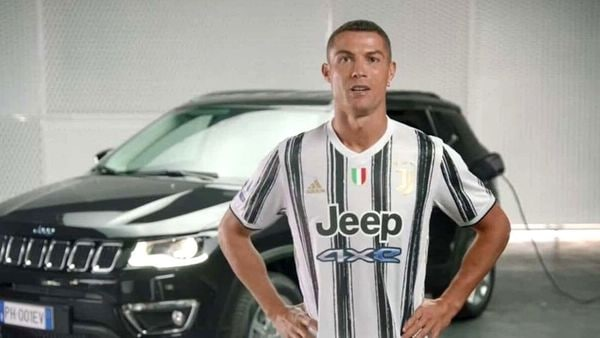 Cristiano Ronaldo, ace striker in the Juventus team, poses with the new Jeep 4xe logo on the uniform.