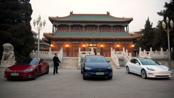 Tesla vehicles parked outside a building at the Zhongnanhai leadership compound during a meeting between Tesla CEO Elon Musk and Chinese Premier Li Keqiang in Beijing. (File photo) (REUTERS)