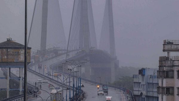 Howrah: Vehicles ply at Howrah Bridge during rain due to the formation of Cyclone Yaas. (PTI)