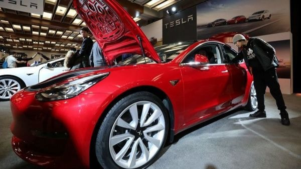 A visitor takes the Tesla Model 3 electric vehicle. (File photo) (Reuters)
