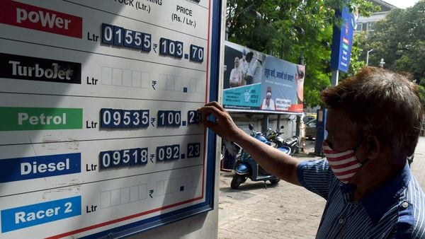 A worker adjusts the petrol prices, as petrol prices cross the 100 rupees after a hike in fuel prices, in Mumbai. (File Photo)