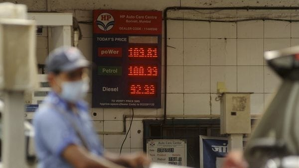 An attendant of a fuel station works as petrol prices cross the 100 rupees per litre mark in Mumbai. (PTI)