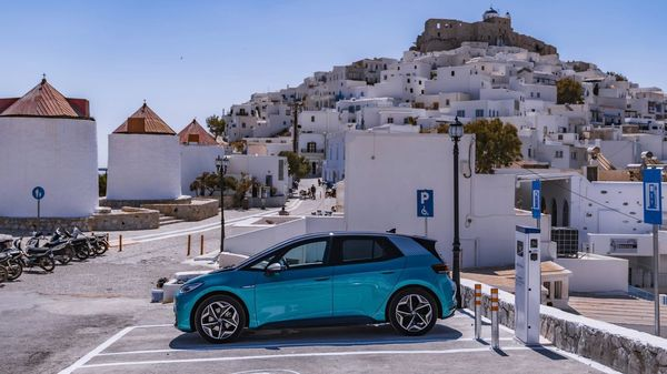 A Volkswagen ID.3 electric car next to an EV charging block in the island of Astypalea in Greece.