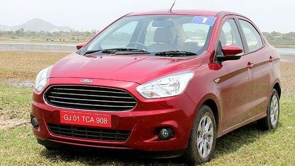 Ford launched its sub-four-metre sedan Figo Aspire starting ₹4.9 lakhs. The car will take on Maruti Suzuki Dzire, Hyundai Xcent and Honda Amaze. (HT Photo)