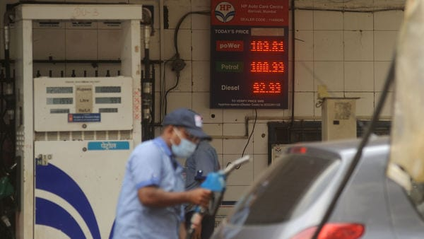 An attendant at a petrol pump fills the fuel tanks of motorists with rates displayed behind him on a digital screen. (Photo by Vijay Bate/HT Photo) (HT PHOTO)