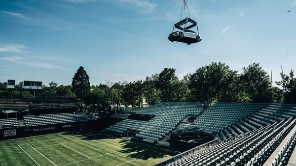 The electric vehicle is seen dangling over the Stuttgart tennis court before the beginning of the tournament. The German luxury automaker said that EQS will be an eye-catcher at Stuttgart's Weissenhof. (Daimler)