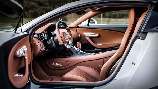 The interior of the Bugatti Chiron Super Sport gets leather and polished aluminium inserts along with high-tech carbon fiber applications. The carmaker claims the interior is perfectly suited to high-speed continental trips.