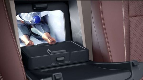 There is a refrigerator on board the Maybach GLS 600 SUV at the rear, to store champagne bottles. It is positioned between the rear seats and can store at least two champagne bottles. Space for two champagne glasses has also been made available.