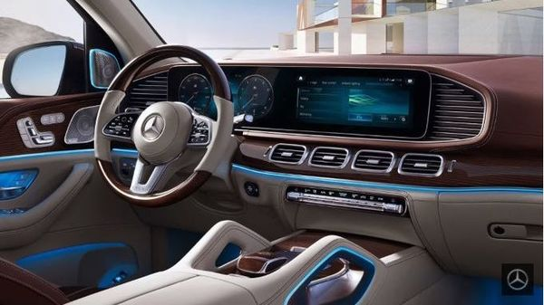 The cabin of the Mercedes Maybach GLS 600 comprises a large 12.3-inch touchscreen infotainment display and a 12.3-inch driver display as well. The MBUX is combined with a Burmester surround sound system and ambient lights. It also gets wireless charging technology.
