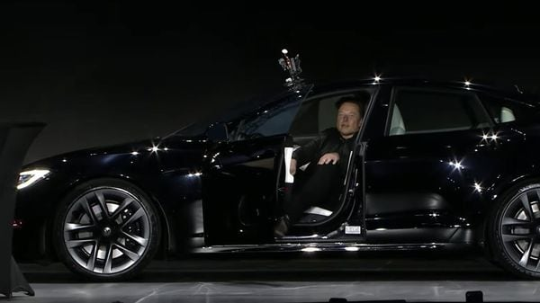 Tesla Model S Plaid being driven on stage by CEO Elon Musk during the launch at the carmaker's Fremont facility in US. (Screengrab from Tesla live event)