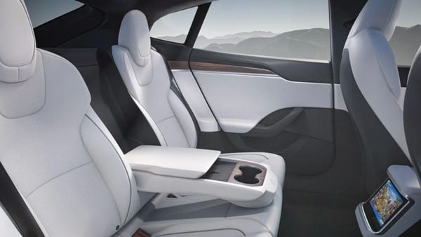 The interiors of the electric car give it a spaceship-like look. It consists of a seating area for three adults with extra leg and headroom and also has a stowable armrest with integrated storage and wireless charging. Tesla took nine years to come out with this performance version of the Model S sedan. (Tesla)