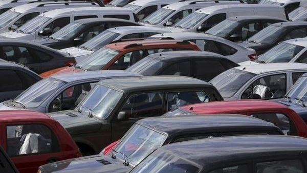 Vehicles, including Lada cars produced by the Russian automobile maker Avtovaz, are parked in Moscow. (File Photo) (REUTERS)