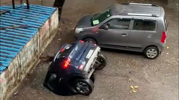 A Hyundai Venue SUV drowned in an abandoned well inside a Mumbai residential complex after the cement cover collapsed due to heavy rain. (Photo courtesy: Twitter/@ians_india)