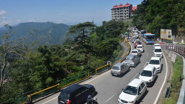 Traffic congestion seen in Shimla as tourists arrive in large numbers following a relaxation in RT-PCR test requirements to visit Himachal Pradesh. (Photo by Deepak Sansta / Hindustan Times)