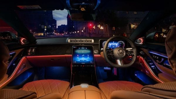 The cabin of the new S-Class sedan features a new 12.8-inch OLED central display which comes integrated with NTG7 MBUX navigation technology. There is a 12.3-inch driver display. The infotainment system can be personalized with voice recognition and finger print sensor technologies.