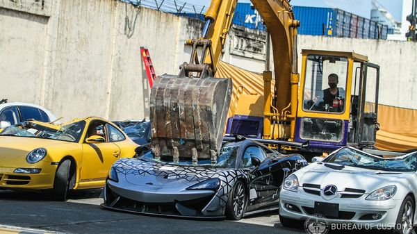 $ 1.2 million worth of luxury cars were crushed in the Philippines.  Here's why