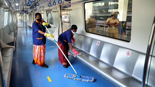 Workers clean a Metro compartment in Bengaluru as services get set to resume from Monday (June 21).