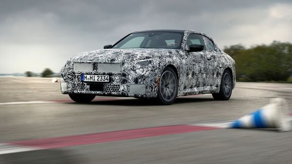 The 2022 BMW 2 Series Coupé covered in camouflage. (BMW)