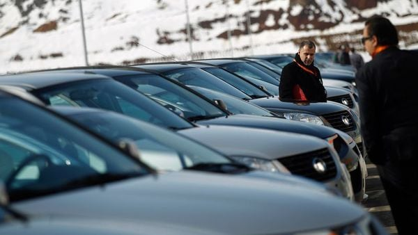 People look at a line of Great Wall Motor cars. (Representational picture) (REUTERS)