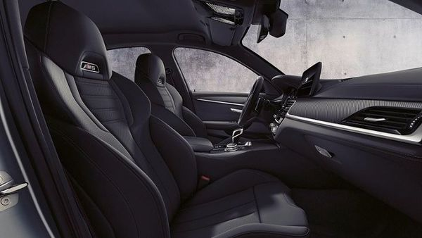 On the inside, there is a 12.3-inch fully digital instrument display and another 12.-3-inch center display.The BMW M5 Competition gets Live Cockpit Professional with BMW Operating System 7.0 which also includes 3D navigation. Other highlights include Harman Kardon Surround Sound System and BMW Display Key.