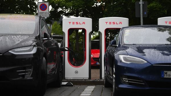 File photo: A Tesla Inc. Model X SUV, left, and a Model S electric automobile charge at a Tesla charging site in Munich, Germany. (Bloomberg)