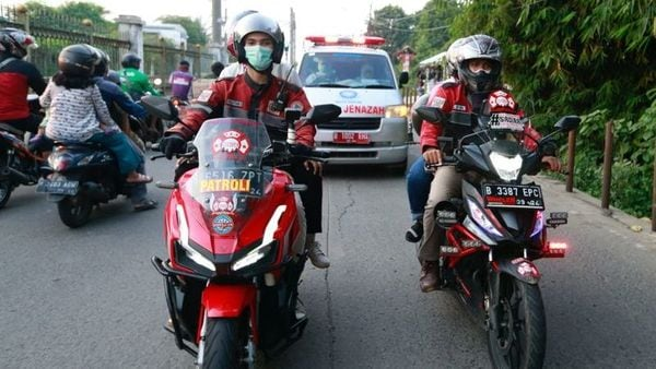 File photo: Volunteer bikers escort an ambulance to a cemetery as coronavirus disease (Covid-19) cases surge in Depok on the outskirts of Jakarta, Indonesia, (REUTERS)
