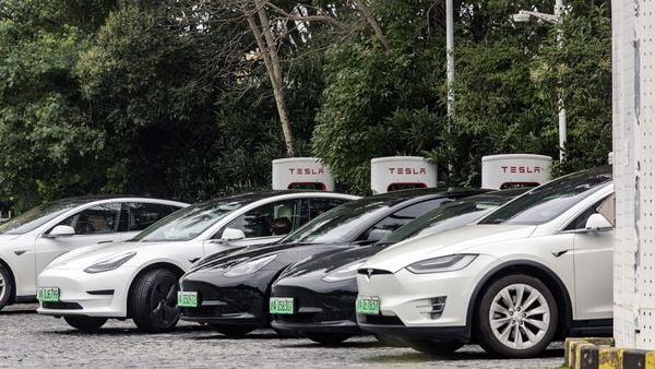File photo of Tesla cars parked at a Supercharger station. (Bloomberg)
