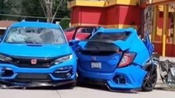 A Honda Civic Type R split into half. (Image credit: Screengrab of a video posted by Vincent Nieto on Facebook)