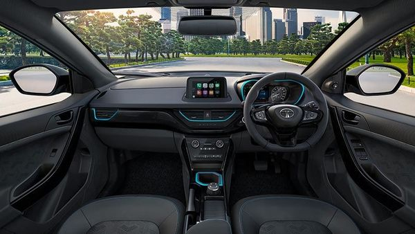 Step inside and the Nexon EV Dark will offer glossy piano Black mid-pad with premium dark themed leatherette upholstery with Tri-arrow perforations on seats and door trims, It is highlighted by EV Blue stitches on the seats and a leatherette wrapped steering wheel.