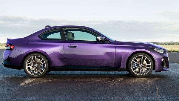 From the sides, the new generation BMW 2 Series gets a long hood, short overhangs. The roofline swoops down from the B-pillar to the short trunk lid.
