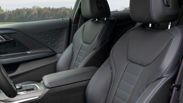 The new BMW 2 Series Coupe gets a more premium cabin with a driver-focused cockpit design. Sport seats and a Sport leather steering wheel come as standard features.