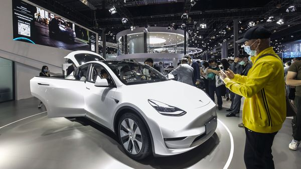 File photo: Visitors look at a China-made Tesla Model Y electric vehicle at the Auto Shanghai 2021 show. (Bloomberg)