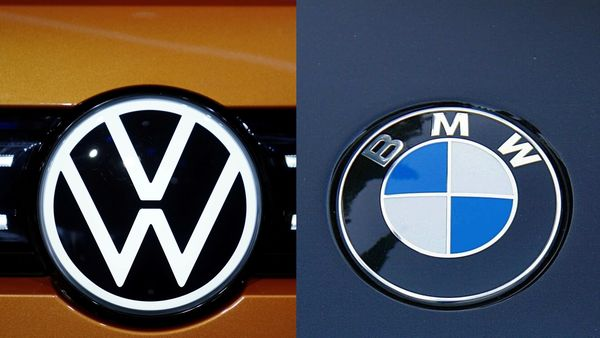 File photo: Logos of Volkswagen (L) and BMW