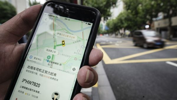 The Didi Chuxing Inc. ride-hailing app is displayed on a smartphone in an arranged photograph in Shanghai, China, on Friday, Sept. 18, 2020. (Bloomberg)