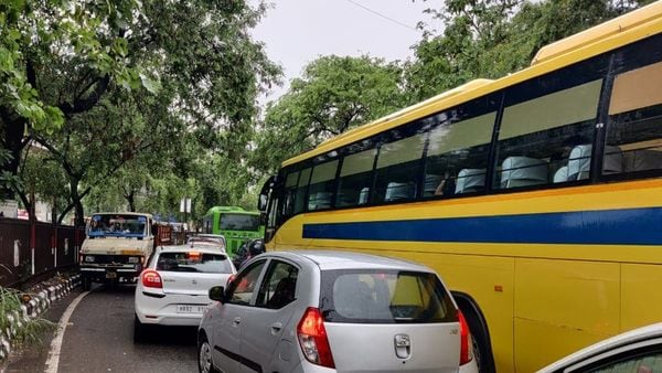 Vehicles stuck in heavy traffic following first showers of monsoon in the national capital. (HT Auto)