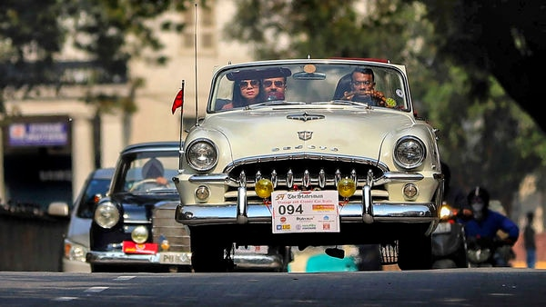Participants ride in their vintage car during the Statesman Vintage and Classic Car Rally at Connaught Place, in New Delhi, on February 23, 2020. (File Photo) (PTI)