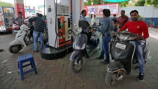 People get their two-wheelers filled with petrol at a fuel station in Ahmedabad.(File photo) (REUTERS)